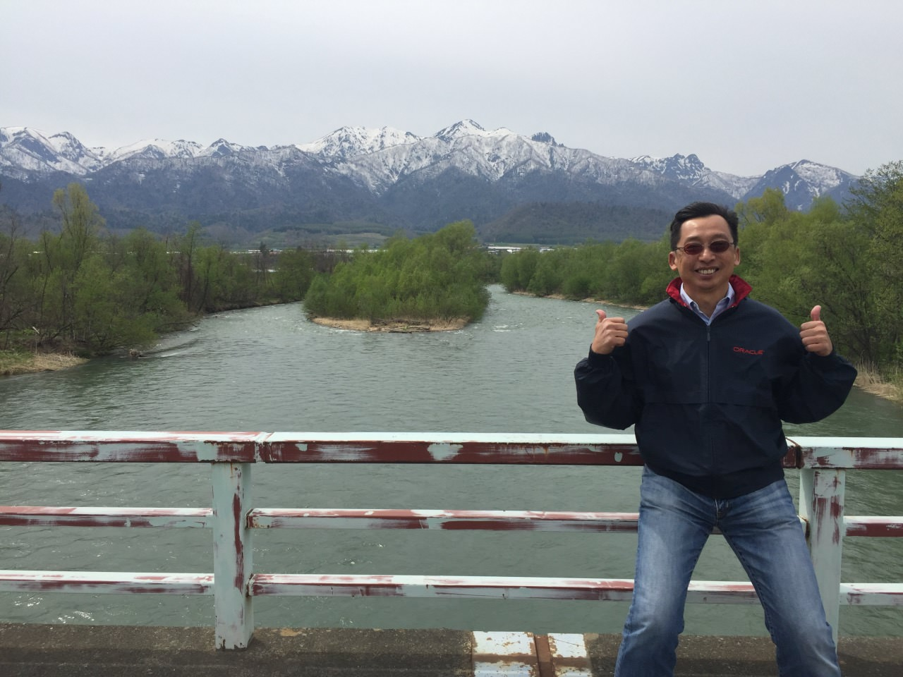 View of the river, plain and the snow capped mountains in clear blue sky is simply beautiful.
