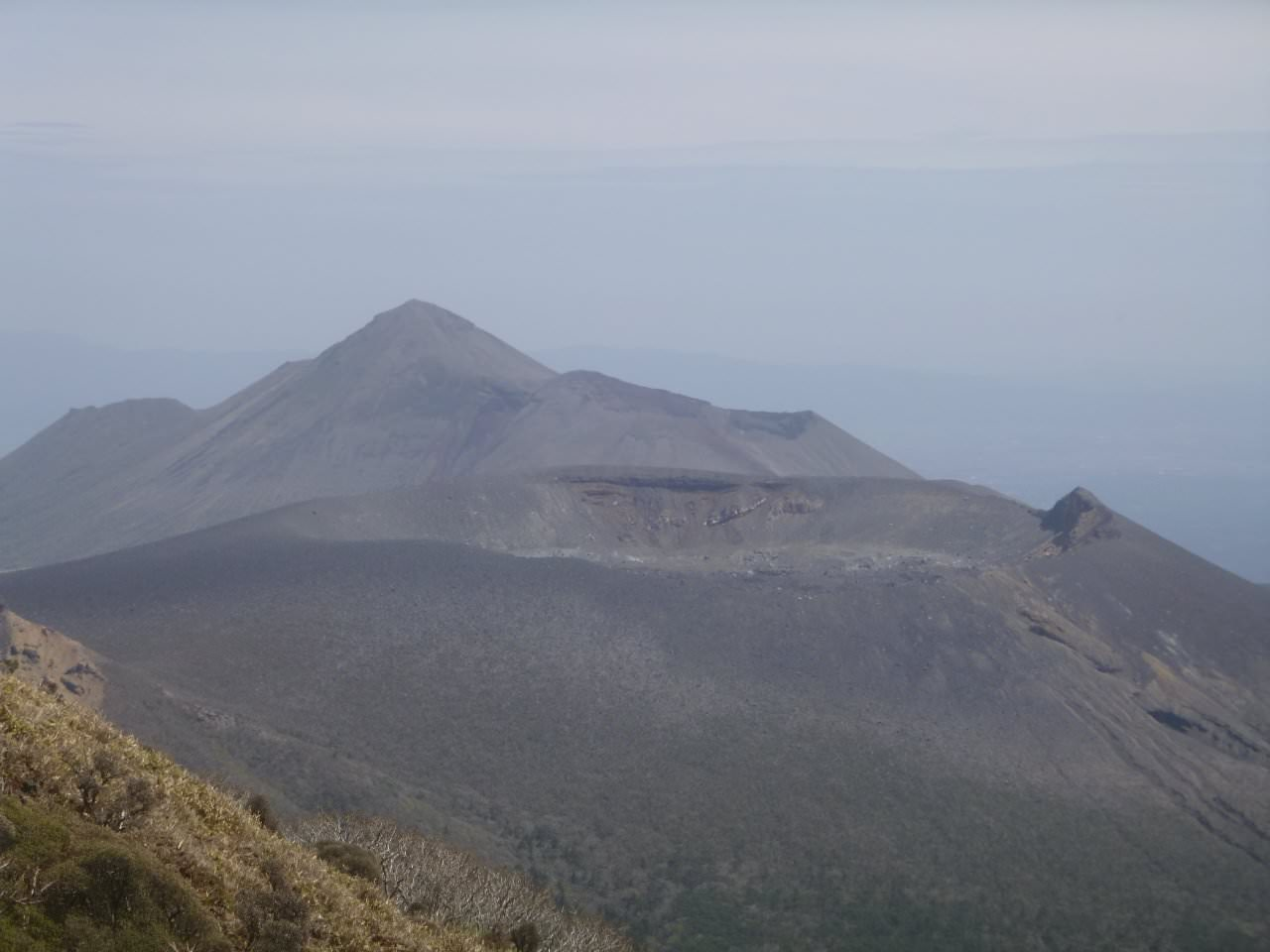 Picture shows Shinmoedake Volcano (front) & Takachihonomine Volcano, in Kirishima National Park