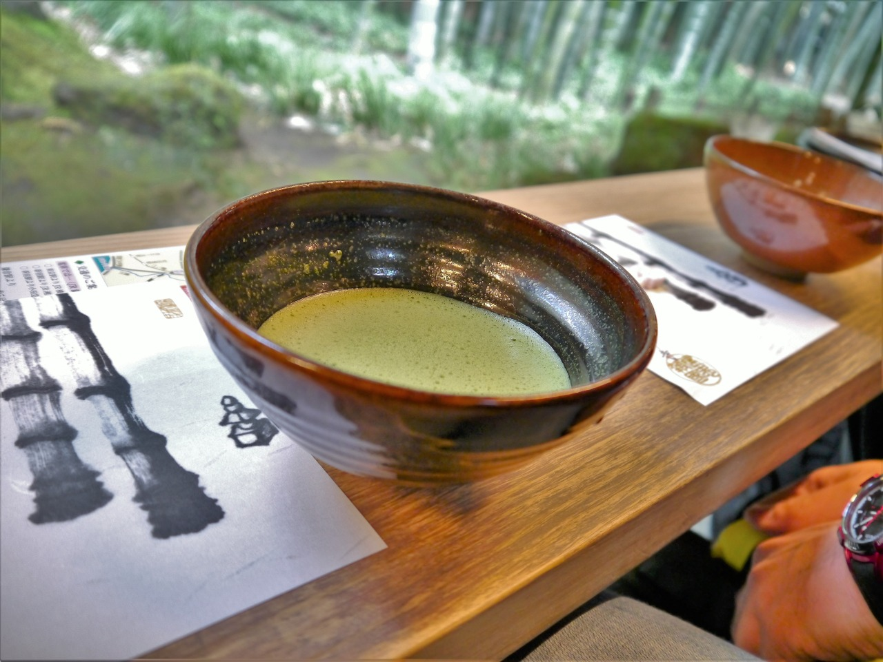 Enjoying a tea ceremony at Hokokuji Temple while viewing bamboo trees