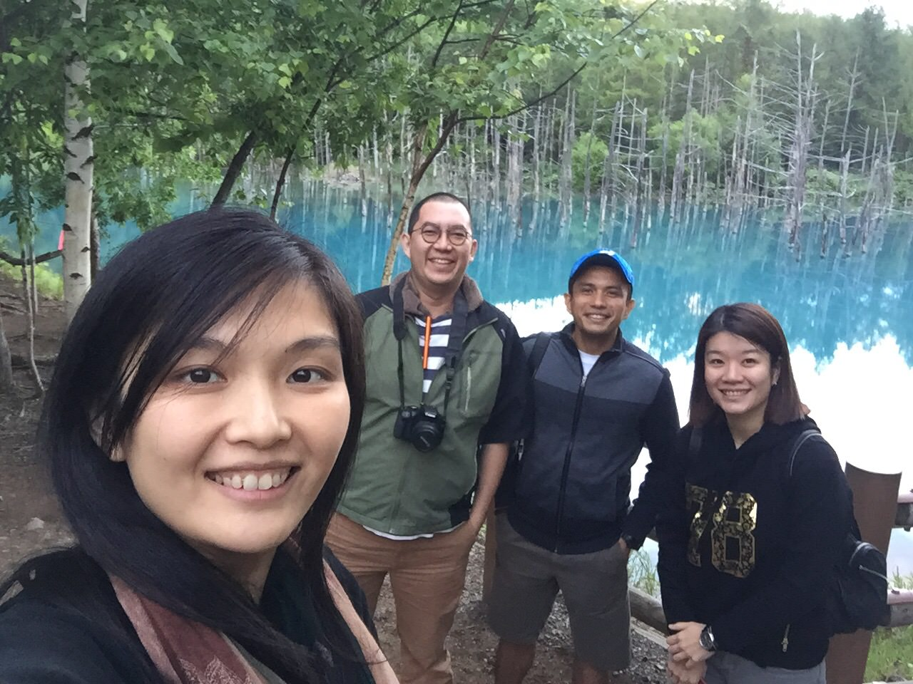 We couldn't help it but to take a wefie with the breath taking blue pond at Biei..