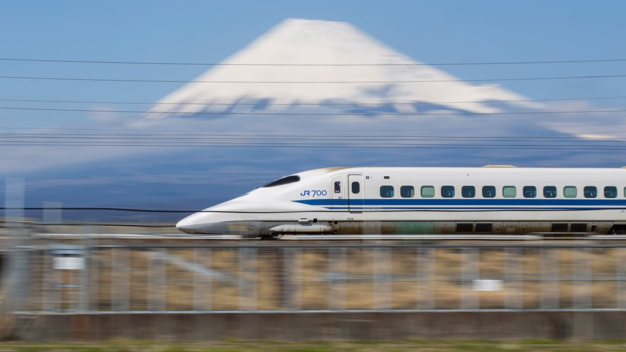 A short drive from Mishima station, A photograph of the Tokaido shinkansen infront of Fujisan