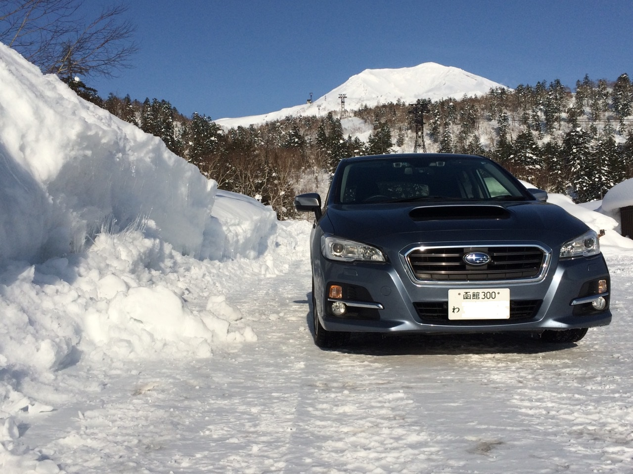 A Toocool car enjoying sun and snow